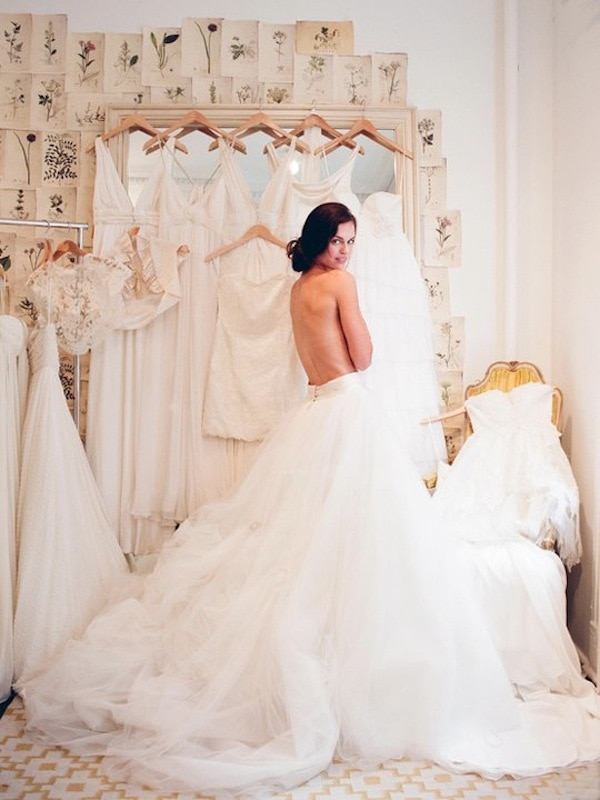 Elizabeth-Messina-bride-trying-on-wedding-dresses